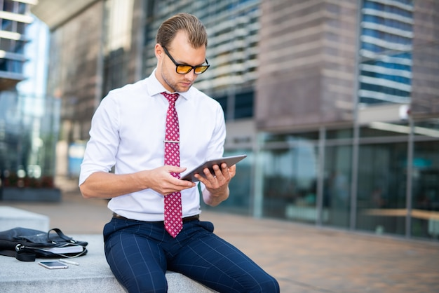 Businessman using a digital tablet in an urban environment