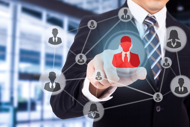 Businessman using finger for touch human icon for crm Premium Photo