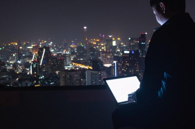Businessman using laptop computer.