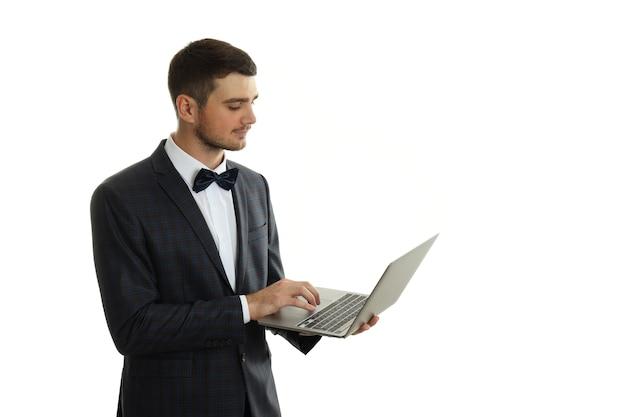 Businessman using laptop, isolated on white background.