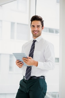 Businessman using laptop and taking notes