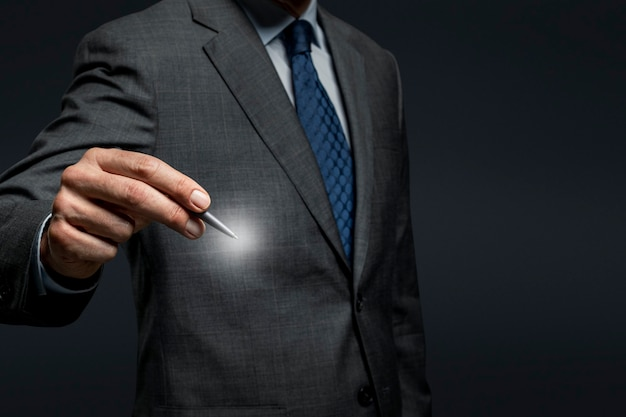 Businessman using a pen and signing on an invisible screen