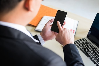Businessman using smartphone in office