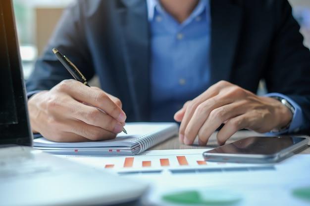 Businessman using smatphone for analysis maketing plan