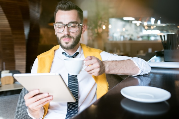 Businessman using tablet in bar