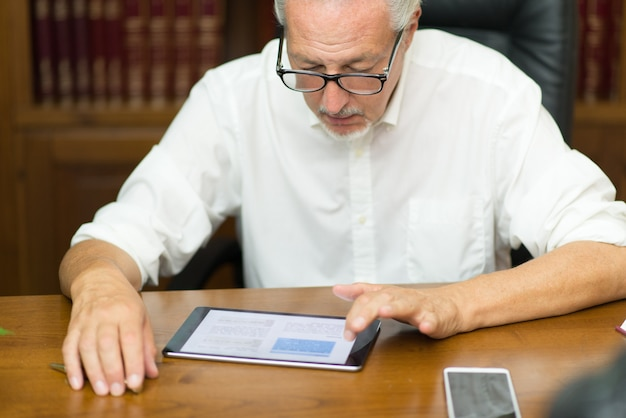 Businessman using a tablet in his business office