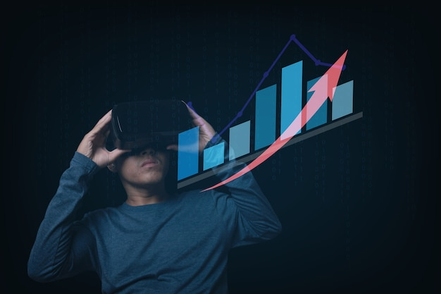 Businessman using virtual reality headset. stock market investments funds and digital assets and analyze forex trading graph financial data. technology online concept.