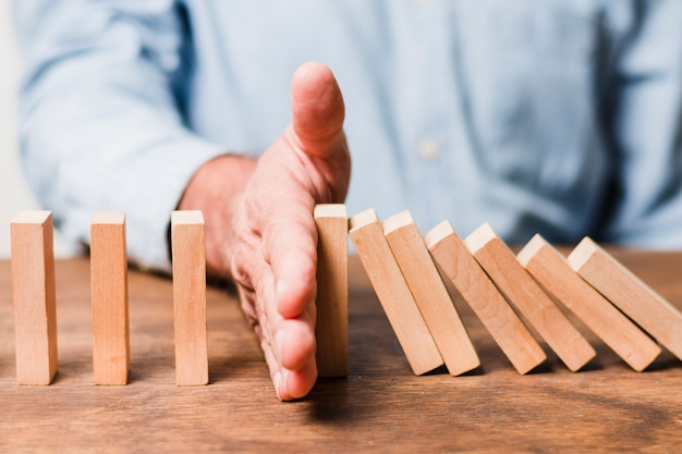 Businessman using wooden pieces