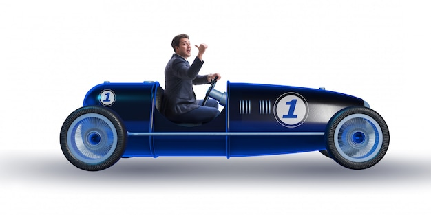 Businessman in vintage roadster isolated on white