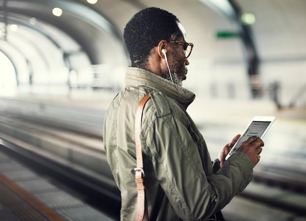 Businessman waiting train station lifestyle concept