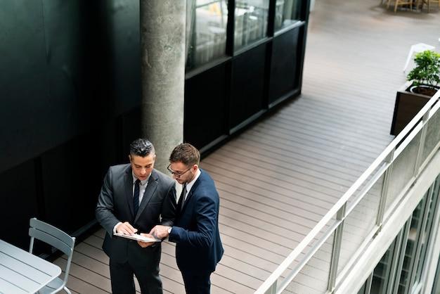 Businessman walking discussion talking work concept