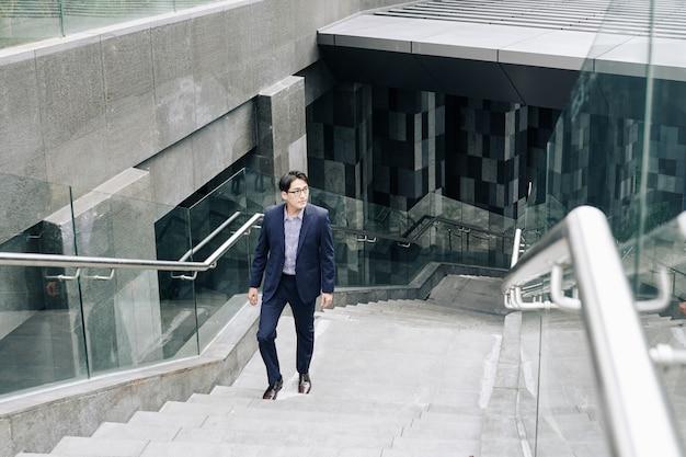 Businessman walking up metro station