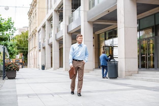 Businessman walks with briefcase