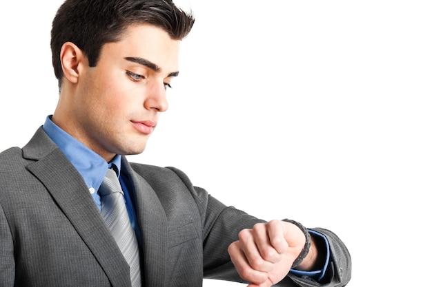 Businessman watching his clock