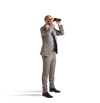 Businessman watching with binoculars on white