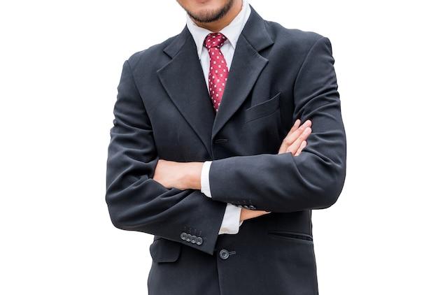 黒のスーツと腕を組んで赤いネクタイを身に着けているビジネスマン、白い背景で隔離