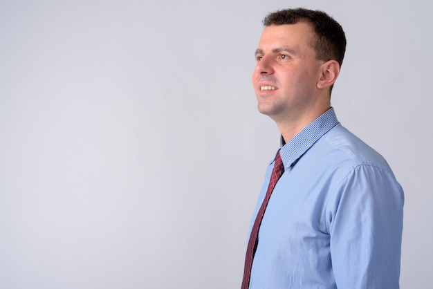 Businessman wearing shirt and tie on white