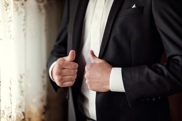 Businessman wears a jacket.politician, man's style,male hands closeup, ,  businessman, business, fashion and clothing concept