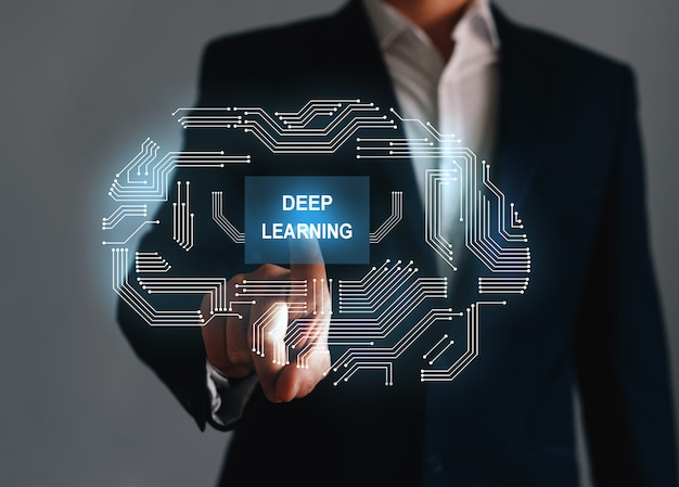 Businessman with abstract devices  of chip, with text deep learning. deep structured learning concept.