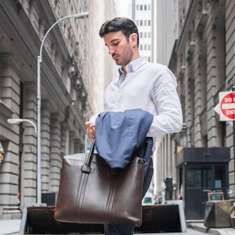 Businessman with bag and cup