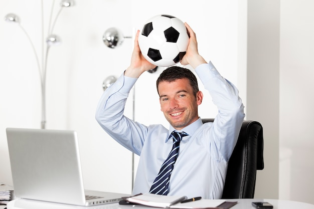 Businessman with ball in office