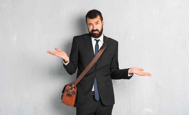 Businessman with beard unhappy and frustrated with something because not understand something