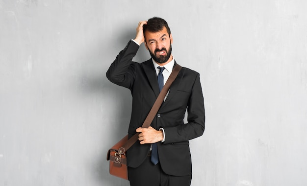 Businessman with beard with an expression of frustration and not understanding