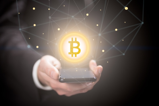 Businessman with bitcoin sign  smartphone