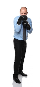 Businessman with boxe glove on white