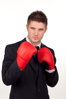 Businessman with boxing gloves on