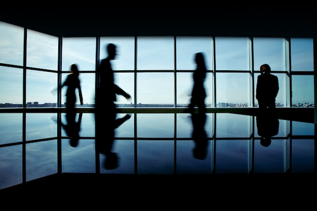 Businessman with businesspeople rushing