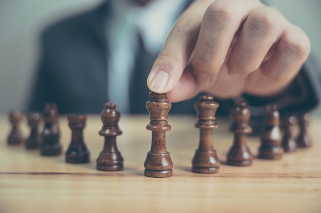 Businessman with chess board game