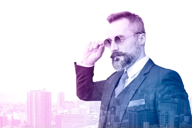 Businessman with colored gradient overlay with city metro background looking futuristic business and development concept.