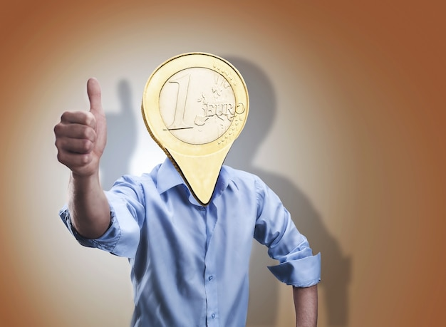 Businessman with an euro coin instead of his head shows thumb up