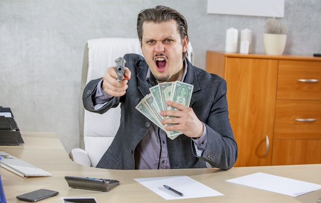 Businessman with a gun and lots of money