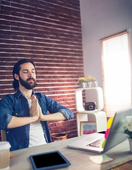Businessman with hand clasped meditating