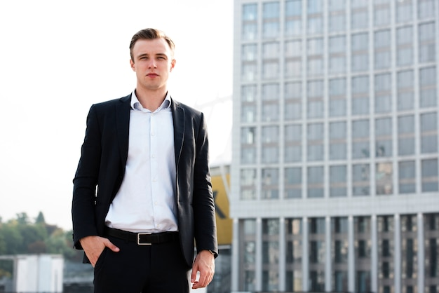 Businessman with hand in pocket looking at camera