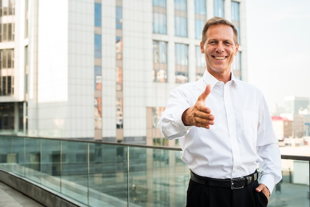 Businessman with hand reaching out