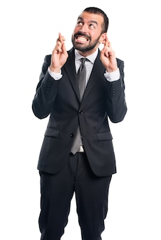 Businessman with his fingers crossing