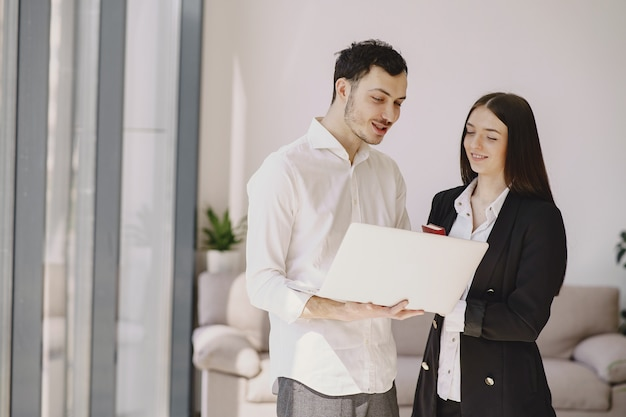 Businessman with his partner working in a office
