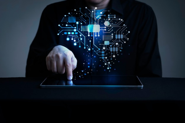 Businessman with holographic human brain interface with digital tablet