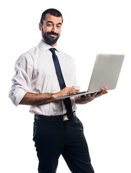 Uomo d'affari con il computer portatile
