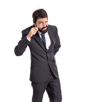 Бизнесмен с увеличительным стеклом на белом фоне