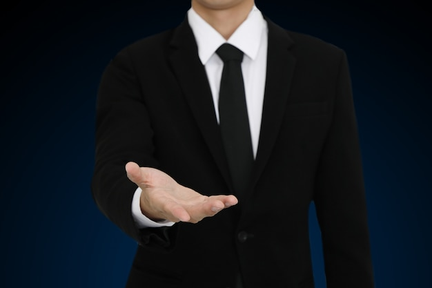 Businessman with open hand gesture presenting blank copyspace