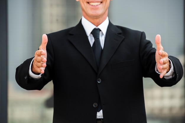 Businessman with palms facing each other