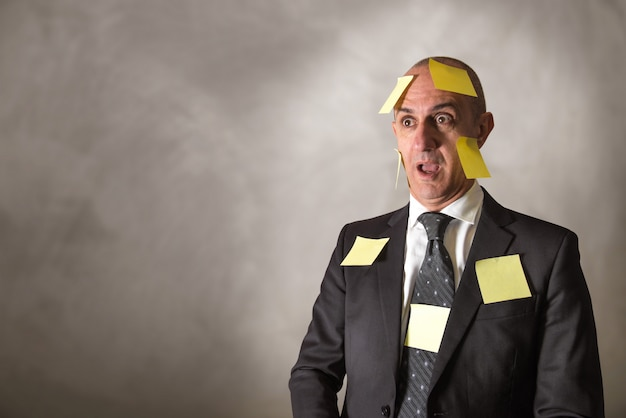 Businessman with post-it head