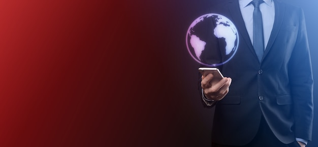 Businessman with protective gesture standing posture hand holding earth icon , digital globe.