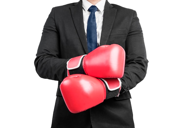 Businessman with red boxing gloves isolated over white wall