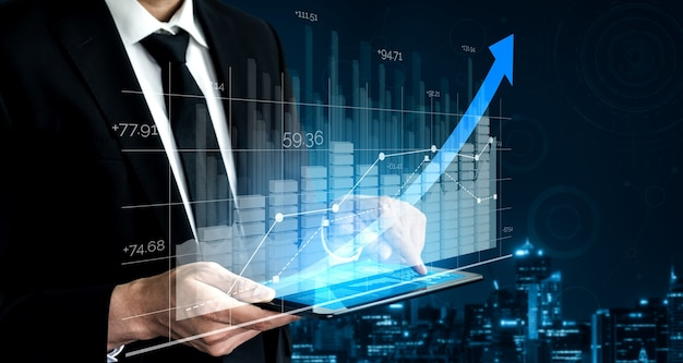Businessman with report chart up forward to financial profit growth of stock market investment.