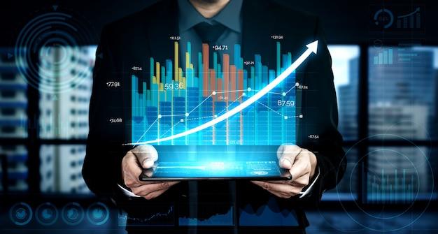 Бизнесмен с диаграммой отчета вперед к росту финансовой прибыли от инвестиций на фондовом рынке.